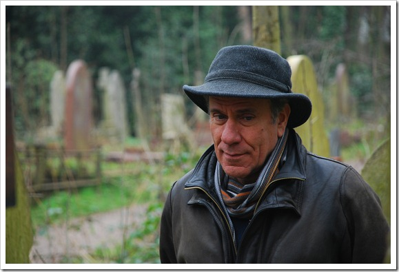 Filming, on location, in a graveyard.